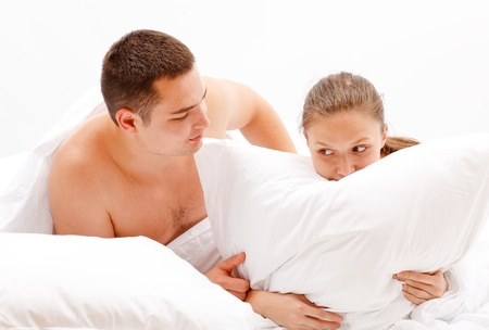 Young naked couple in bed, man comforting woman Stock Photo - 10658843
