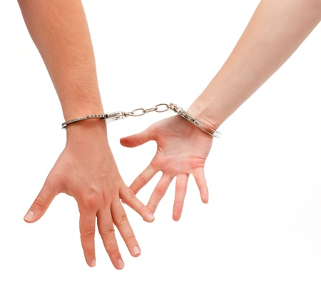 wrist cuffs: Man and woman hands handcuffed together by the wrist