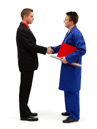 Young businessman meeting engineer and shaking hands photo