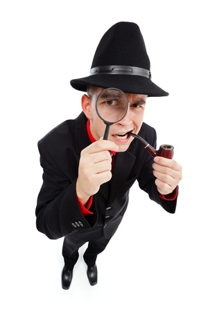 Skeptical detective with pipe in his mouth looking up through magnifying glass photo