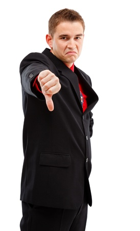 Young businessman showing disappointment/disapproval with thumbs down Stock Photo - 10658828