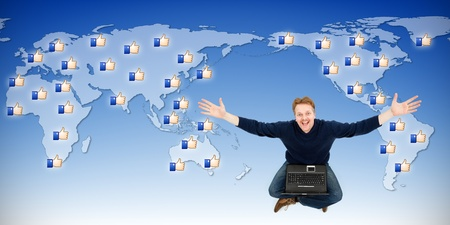Happy social networking man sitting with laptop, receiving likes from around the world Stock Photo - 10813549
