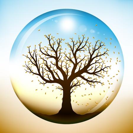 ガラス球内部、閉じている落下の黄色の葉の秋のツリー