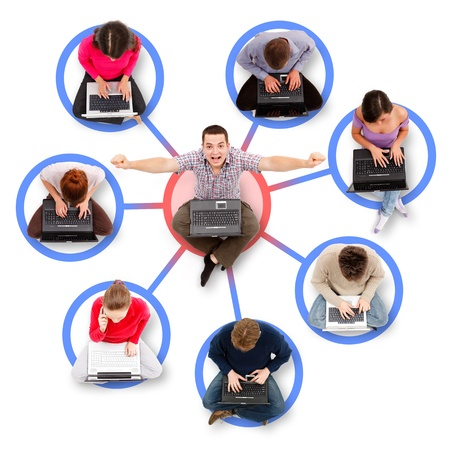 relation: Social network members sitting with their laptop computers around a successful, happy man