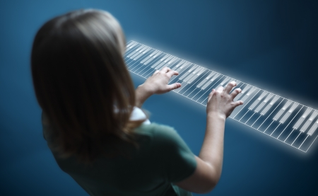 futuristic girl: Young girl playing music on virtual piano keyboard