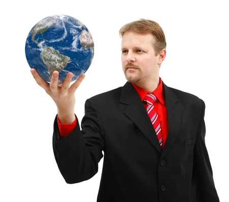 Powerful business man looking at Earth globe held in his hand photo