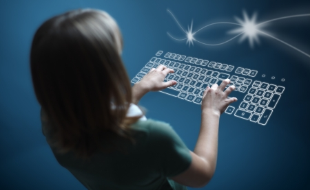 Back view of a teenager girl, typing on virtual keyboard photo
