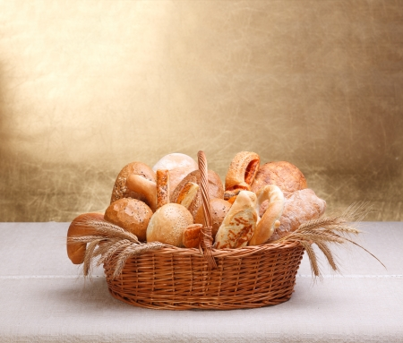 Lots of assorted bakery products in basket, big copy space on top photo