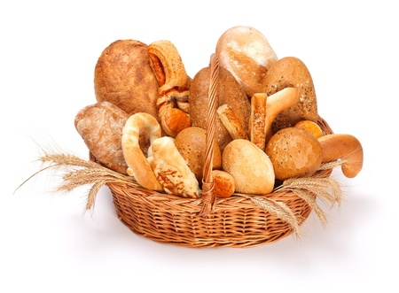 Fresh baked bread and pastry in basket on white background