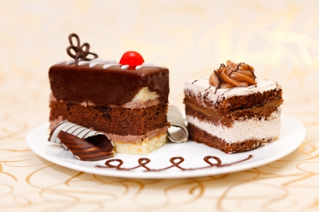 Two chocolate cakes on plate on golden background Stock Photo - 14831718