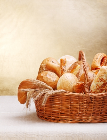 Assortment of bakery products on basket. Copy space above Stock Photo - 14831755