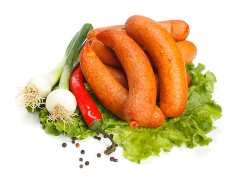 Dry sausages on lettuce, pepper and onion decoration Stock Photo - 15027953