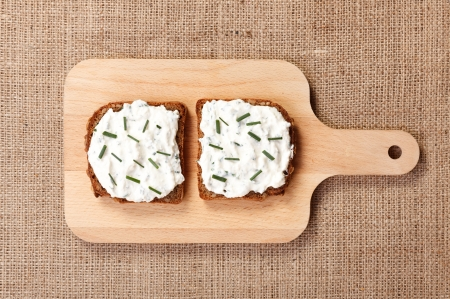 Two slices of spicy buttered bread with green onion on top on wooden board Stock Photo - 15027986