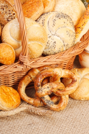 Composition of vaus baked products in basket on rustic background Stock Photo - 15027988
