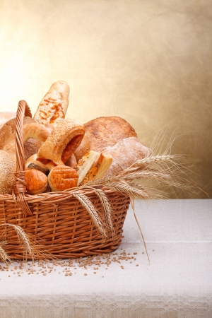 Variety of baked products in basket. Copy space above Foto de archivo