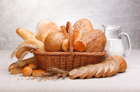 Fresh bread and pastry with milk on jug Stock Photo - 15032495