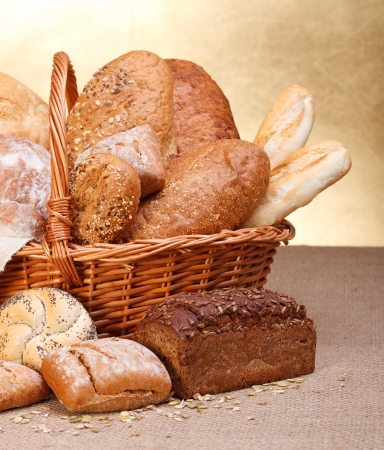 sesame seed bun: Various breads in basket on canvas tablecloth Stock Photo