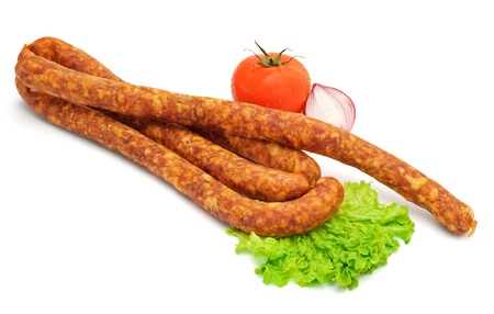 Smoked sausage with lettuce, tomato and onion on white background Stock Photo - 16059558