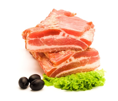 Two pieces of smoked raw bacon each other with lettuce and olives on white background Stock Photo - 16059560