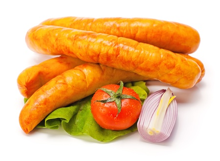 Turkey sausages on lettuce, tomato and onion decoration Stock Photo - 16059575