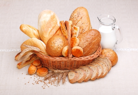 bread basket: Fresh bread and pastry with milk on jug
