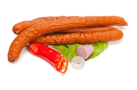 Turkey sausages on lettuce, pepper and onion decoration Stock Photo - 16059567