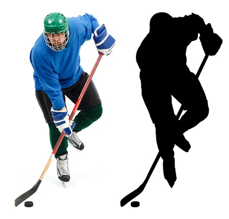 Ice hockey player in blue wear, skating fast and handling puck.