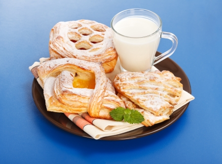 Breakfast  apple, peach, sour cherry cakes and milk on plate Stock Photo - 17688248