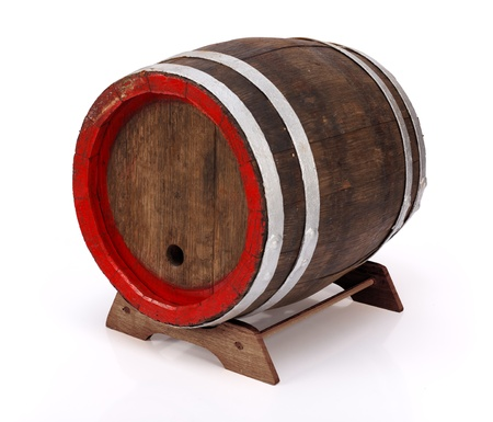 Old handmade oak barrel on wooden stand Stock Photo - 17688173