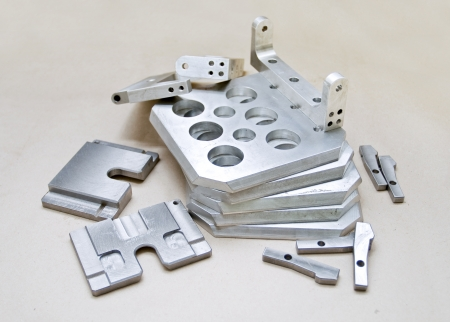 molds: Finished aluminum mold pieces on paper Stock Photo