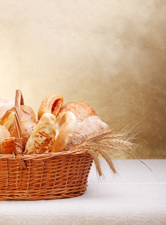 bakery products: Assortment of bakery products on basket. Copy space above