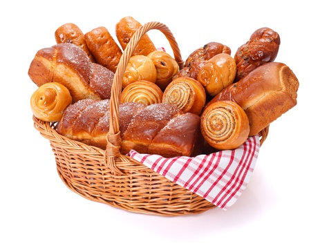 bakery products: Lots of sweet bakery products in basket, white background Stock Photo