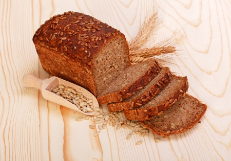 Brown sliced bread with seeds on wooden board Stock Photo - 19112021