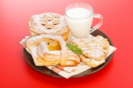 Breakfast: apple, peach, sour cherry cakes and milk on plate Stock Photo - 19112023