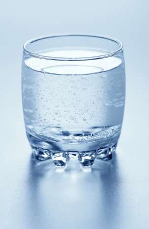 A glass full of sparkling water photo