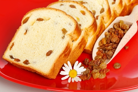Macro of sweet loaf slices with raisins on red plate Stock Photo - 19112016