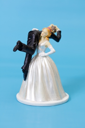 topper: Bride and groom cake topper on blue background
