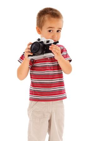 stock photograph: Serious little boy taking photos