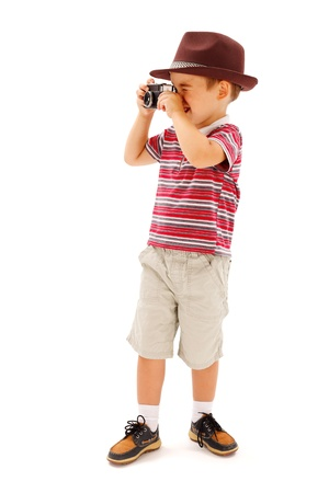 people  camera: Little boy in hat, taking photos with an old fashioned camera