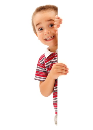 Funny little boy mime scary expression from behind white wall
