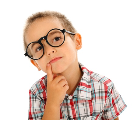 think big: Wise little boy thinking, wearing big glassess Stock Photo