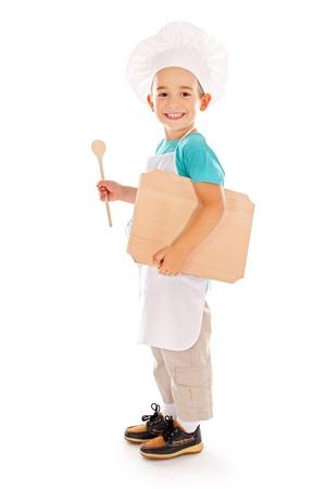 Heureux petit garçon comme chef avec conseil d'administration et la cuillère de bois Banque d'images - 22163126