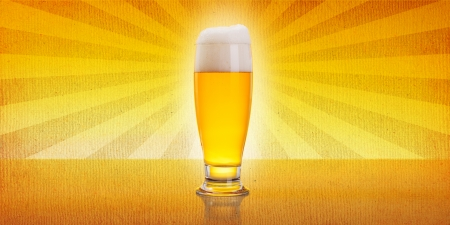 Glass full of beer over vintage background photo