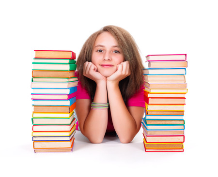 kindly: Pretty adolescent girl between bunch of colorful books smiling kindly