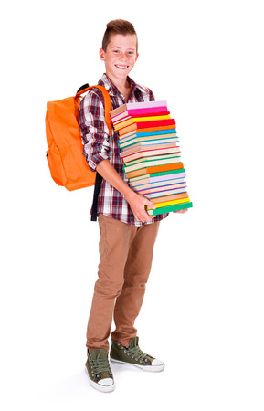 secondary schools: Young boy holding bunch of colorful books prepared for school