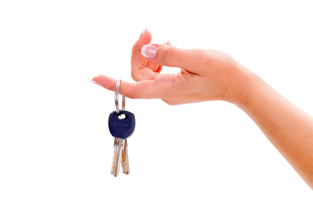 Womans hand holding pair of house keys photo