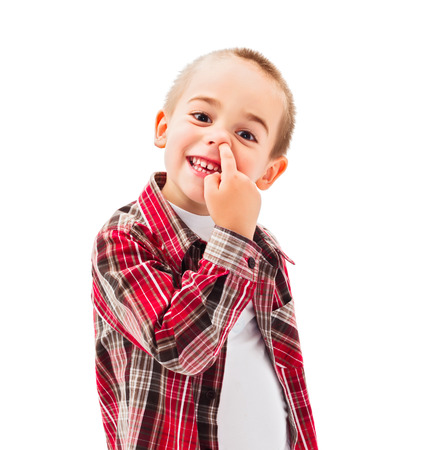 Funny little boy enjoying picking his nose photo