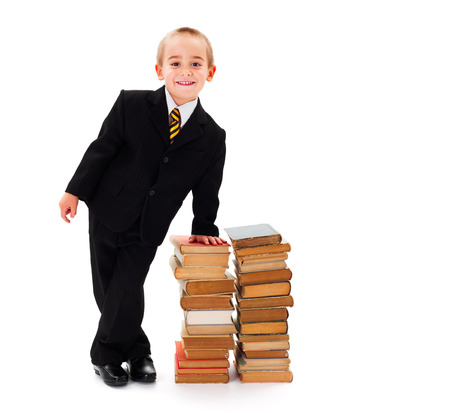 little business man: Poco hombre de negocios junto a una pila de libros Foto de archivo