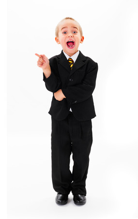 Laughing little kid pointing towards copy space photo