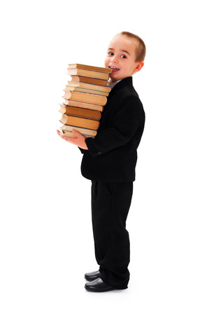 Little businessman holding a bunch of books photo